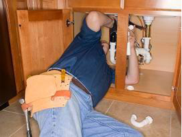 Plumber in Carlsbad CA replaces a sink drain